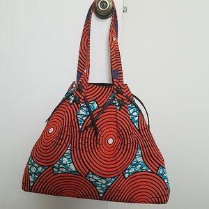 Designer mod print hand bag with leather detail